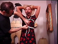 Cute blonde gagged and bound while her tits are fondled