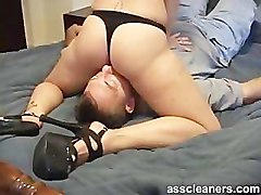 Mistress in heels and bikini sits her nice ass on man's face