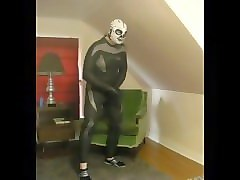 wetsuited lucha libre skeleton masked frogman playing with his cock