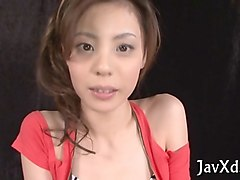 skinny japanese  lady in redtoys her pussy with a toy