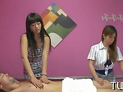 two sluts give an erotic massage to a horny stud