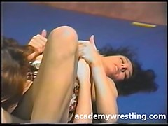 busty blondie takes on sexy, brunette in academy wrestling