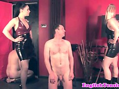 latex dominas subdue slave into cumlicking