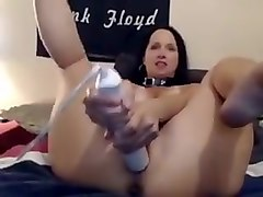 Brunette on webcam toying her horny pussy madly and teasing with her swollen pussy