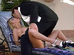 Hot blonde with big boobs gets nailed by the pool with cocks