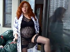 Naughty Gigi is a naughty redhead in black