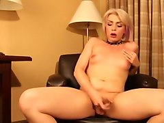 Blonde shemale plays with dick