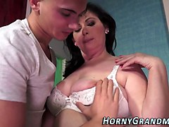 a chubby granny is getting pounded by a younger gentleman with a nice strapping tool