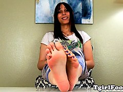 pedicured tgirl puts oil on her feet