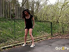 sporty babe in black dress urinates near tennis court
