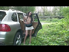 lean brunette sexy babe out of a fancy car flashes her breasts and pussy