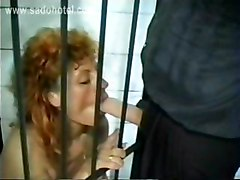 Milf Slave Sitting In A Jail Is Forced To Suck A Cock And Got Peed On Her Nice Tits By Master