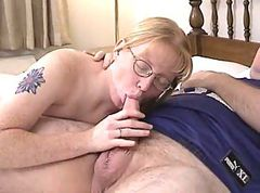 Blonde Milf wearing glasses blows and fucked